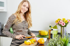 Blonde woman using a tablet computer to cook Royalty Free Stock Photos