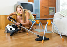 Blonde woman with vacuum cleaner Royalty Free Stock Images