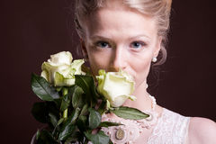 Blonde woman in victorian dress with roses in hands Stock Photos