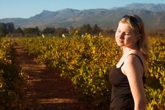 Blonde woman in the vineyards Royalty Free Stock Photo