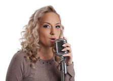 Blonde woman with vintage microphone Royalty Free Stock Photos