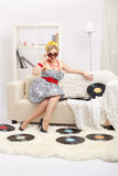 Blonde woman with vinyls Royalty Free Stock Photo