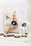 Blonde woman with vinyls Royalty Free Stock Photography