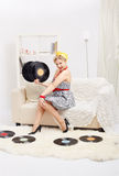 Blonde woman with vinyls Stock Image