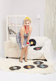 Blonde woman with vinyls Stock Photo