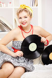 Blonde woman with vinyls Stock Images