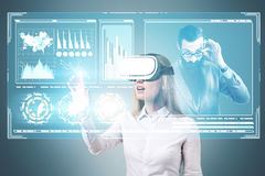 Blonde woman in VR glasses, boss, HUD Royalty Free Stock Photos