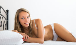 Blonde woman waking on bed Stock Photography