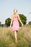 Blonde woman walking in nature Stock Image