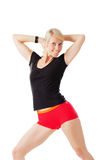 Blonde woman warming up her body by stretching Royalty Free Stock Images