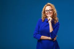 Blonde woman wearing blue dress Royalty Free Stock Images