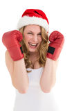 Blonde woman wearing boxing gloves smiling at camera Stock Image