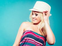 Blonde woman wearing colorful striped strapless shirt. Summer trendy fashionable outfit ideas concept. Blonde woman wearing colorful striped strapless shirt and Stock Photos