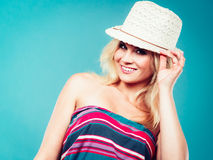 Blonde woman wearing colorful striped strapless shirt Stock Photos