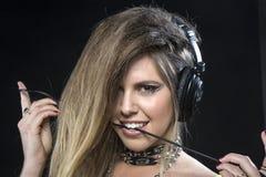 Blonde woman wearing headphones Royalty Free Stock Photo