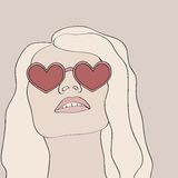 Blonde woman wearing heart glasses Royalty Free Stock Photos