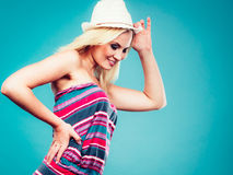 Blonde woman wearing short colorful striped dress Stock Images