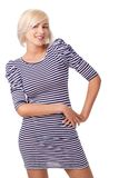 Blonde woman wearing striped dress Stock Photography