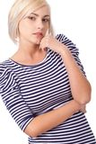 Blonde woman wearing striped dress Stock Photos