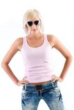 Blonde woman wearing sunglasses. Blonde woman fashion portrait wearing sunglasses and pink tank top Royalty Free Stock Photography