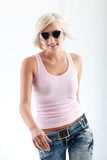 Blonde woman wearing sunglasses Stock Images