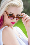 Blonde Woman Wearing Sunglasses Outside Stock Photography