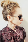 Blonde woman wearing sunglasses. Portrait in profile of beautiful blonde woman wearing sunglasses on white background Royalty Free Stock Photos