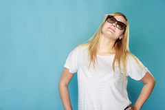 Blonde woman wearing sunglasses and summer clothing. Summeral outfit ideas, fashion, clothes concept. Blonde woman wearing sunglasses and summer clothing. Studio Stock Photo