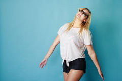 Blonde woman wearing sunglasses and summer clothing. Summeral outfit ideas, fashion, clothes concept. Blonde woman wearing sunglasses and summer clothing. Studio Stock Image