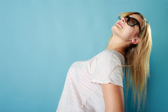 Blonde woman wearing sunglasses and summer clothing. Summeral outfit ideas, fashion, clothes concept. Blonde woman wearing sunglasses and summer clothing. Studio Stock Photography