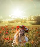 Blonde woman in the wheat field royalty free stock photo