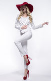Blonde woman in white costume Royalty Free Stock Photos