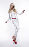 Blonde woman in white costume Royalty Free Stock Photography