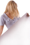 Blonde woman with white sheet of paper. #1 Stock Photo