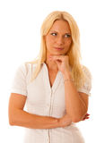 Blonde woman in white shirt blue jeans isolated over white backg Stock Images
