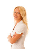 Blonde woman in white shirt blue jeans isolated over white backg Stock Photo