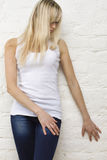 Blonde woman in white t-shirt Royalty Free Stock Photos