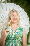 Blonde Woman with white Umbrella royalty free stock image