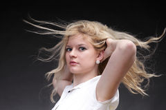 Blonde woman with wind in her hair isolated on black Royalty Free Stock Photos