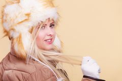 Blonde woman in winter furry hat. Accessories and clothes for cold days, fashion concept. Blonde woman in winter warm furry hat in russian style Royalty Free Stock Photography