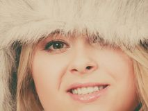 Blonde woman in winter furry hat. Accessories and clothes for cold days, fashion concept. Blonde woman in winter warm furry hat in russian style Royalty Free Stock Photos