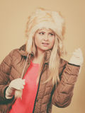 Blonde woman in winter furry hat Stock Images