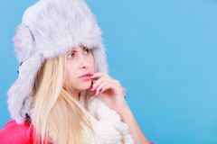 Blonde woman in winter furry hat Royalty Free Stock Images