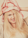 Blonde woman in winter furry hat Royalty Free Stock Photo