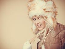 Blonde woman in winter warm furry hat Stock Image