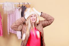 Blonde woman in winter warm furry hat Stock Images