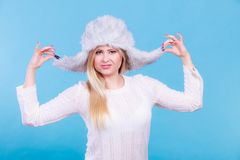 Blonde woman in winter warm furry hat Royalty Free Stock Images