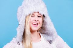 Blonde woman in winter warm furry hat Stock Photography