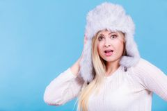Blonde woman in winter warm furry hat. Accessories and clothes for cold days, fashion concept. Blonde woman in winter warm furry hat in russian style Royalty Free Stock Photos