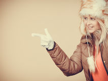 Blonde woman in winter warm furry hat Stock Photo